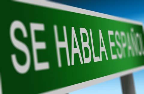 Cartel verde sobre la nacionalidad española por residencia